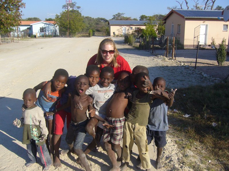 A development instructor with a group of children in Namibia