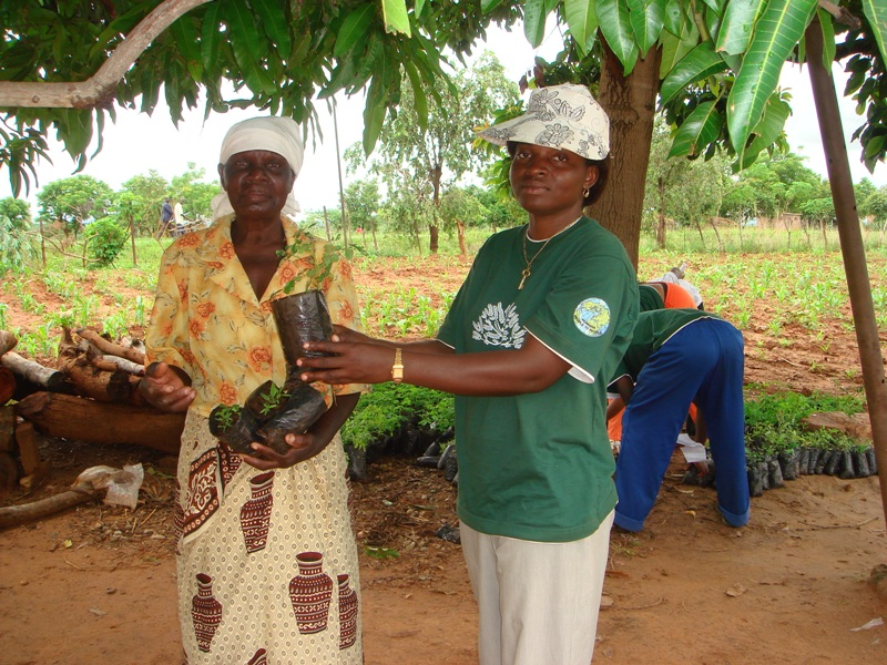 A Humana team member with a local woman